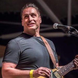 Guitarist Joe Moss with Flying V Guitar
