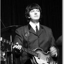 Eric Michaels playing a bass guitar