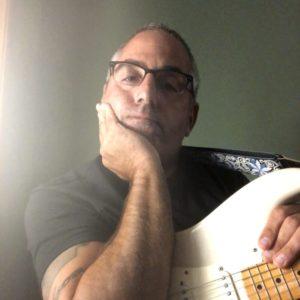 Guitarist Tom Castonzo with white Fender stratocaster