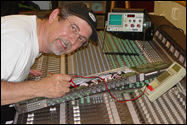 ICM Corp founder Tim Bernovich working on a large studio mixing board